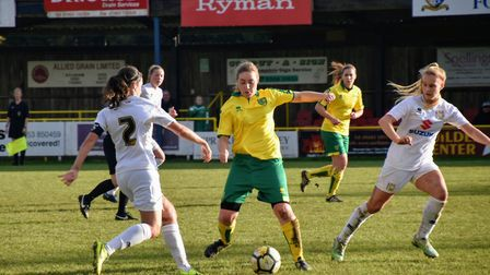 Norwich City Ladies' Emily Moerkerk's gets a block in against MK Dons. Picture: Brian Coombes