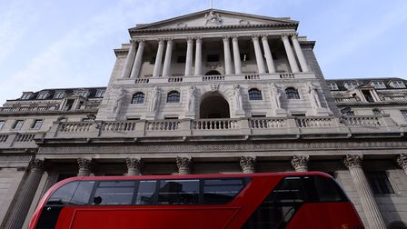 A bus passes the Bank of England, London, as the Bank's Monetary Policy Committee has voted to raise