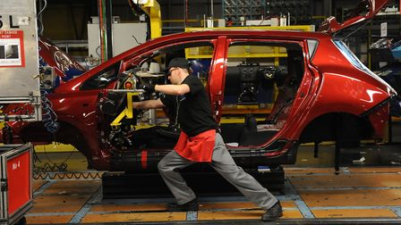 A dashboard being fitted on a manufacturing line, as new figures reveal that car production increase