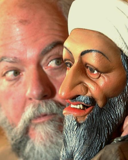 Roger Law, creator of Spitting Image, gets eye to eye with his model of Osama Bin Laden. Photo: Toby