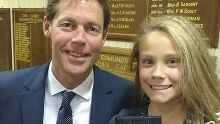 Beccles cricketer Evie Booker collects her award from former England batsman Nick Knight. Picture: S