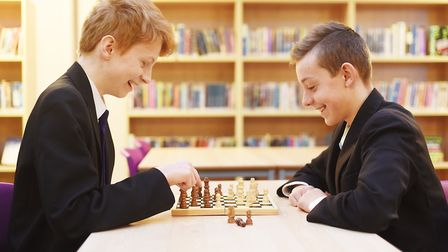 Having a game of chess in the newly updated library at the Downham Market Academy are (L) Charlie Mu