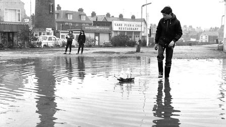 Boy and boat in puddles on Brush Quay, Gorleston, 1967. Photo: Brian Ollington Archive/Great Yarmout