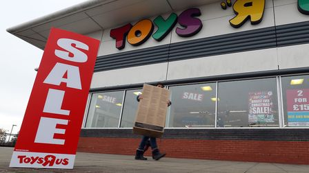 Sale signs outside a Toys R Us store as the company faces filling a �9m pension gap or going into ad