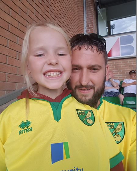 Dan Gilson, 34, from Kent, who sits in the Barclay End with his 11-year-old daughter Faith and his m
