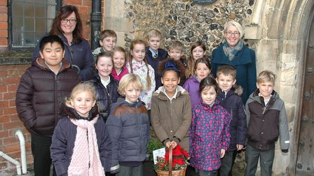 Ruth Royle, chair of governors, and Mrs Alison Clarke, headteacher, with pupils from Robert Kett Pri