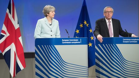 European Commission President Jean-Claude Juncker Theresa May attend a joint press conference in Bru