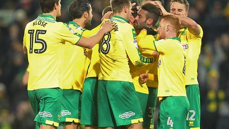Norwich City's players surround Nelson Oliveira, following his injury-time penalty that sealed a 3-1
