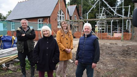 Members of the Heart of Gissing charity during construction of the new building. From left, Howard D