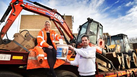 Claire Wright from GB Digger Hire handing over a cheque to reporter Peter Walsh for Kerri's Campaign