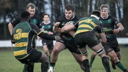 Lachlan Brown-Bates attempts to muscle his way through for North Walsham against Old Priorians on th