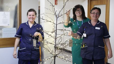 Pictured with the Christmas Wish Tree are Rapid Assessment Team Lead Nurse Sara Tansley, Chief Opera