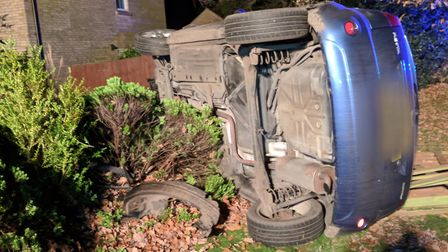 Car embedded in fence in Little Plumsted, Norfolk (Picture: Christian Hall)