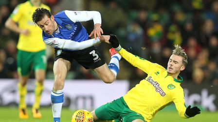 James Maddison digs in against David Jones as Norwich City earn a first win in eight Championship ma