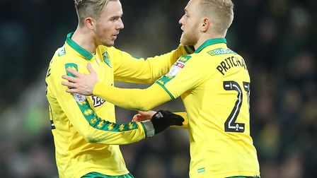 James Maddison and Alex Pritchard celebrate combining for Norwich City's equaliser against Sheffield