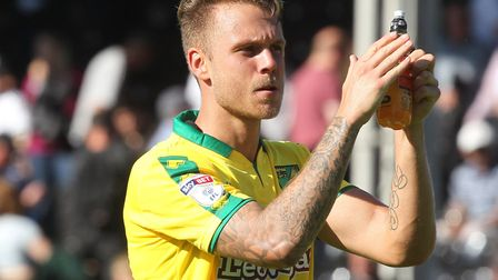 Marcel Franke applauds the travelling Norwich fans following the 1-1 draw at Fulham on the opening d