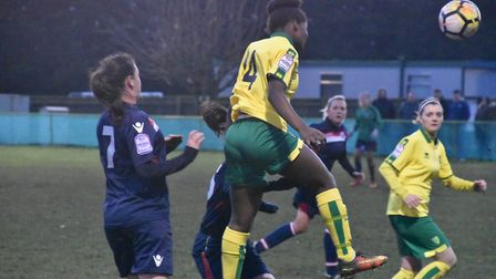 Norwich City Ladies' Vivian Moyo rises high. Picture: Brian Coombes