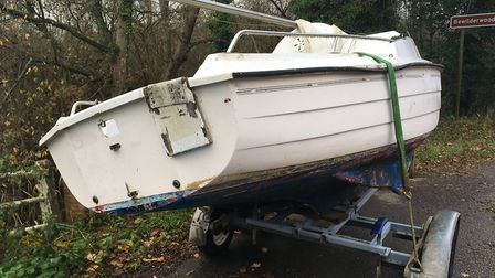 Police are trying to trace the owner of a boat left on the side of the road between Horning and Hove