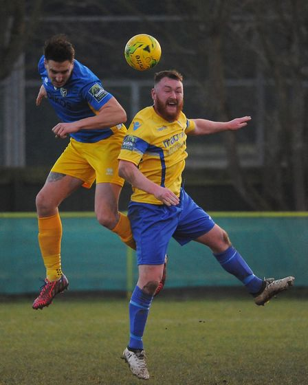 Sam Applegate, right, in aerial action for Norwich United. Picture: DENISE BRADLEY