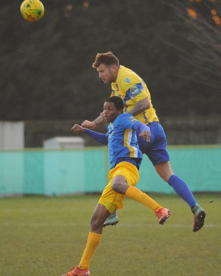 Shaun Wones wins a header for Norwich United. Picture: DENISE BRADLEY