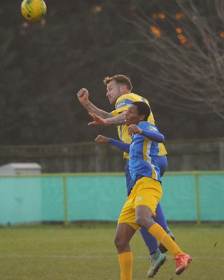 Shaun Wones in an aerial battle for Norwich United. Picture: DENISE BRADLEY