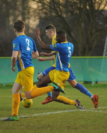 Liam Jackson tries to keep Canvey opponents at bay. Picture: DENISE BRADLEY