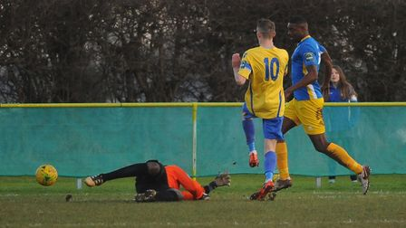 Liam Jackson gets the ball past the Canvey Island goalkeeper Ashlee Jones. Picture: DENISE BRADLEY