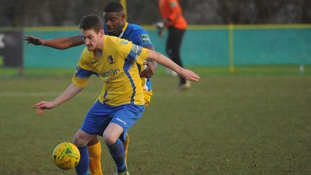 Norwich United's Adam Hipperson shields the ball. Picture: DENISE BRADLEY