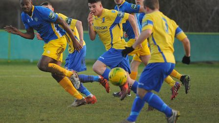 Norwich United's Henry Pollock, centre, and Tim Henery, front. Picture: DENISE BRADLEY
