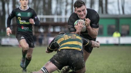 North Walsham's Will Hodgson is stopped in his tracks by an Old Priorians tackle. Picture: Hywel Jon