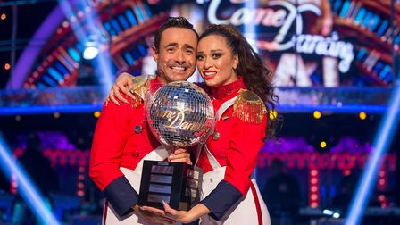 Handout photo issued by the BBC of Katya Jones and Joe McFadden with the glitterball trophy after th