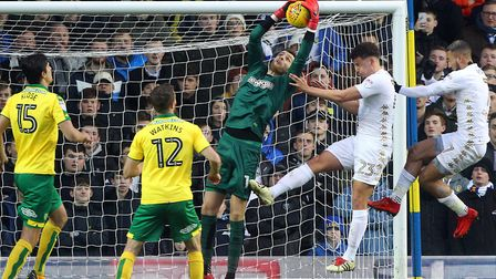 Norwich City goalkeeper Angus Gunn claims a cross under Leeds United pressure at Elland Road. Pictur