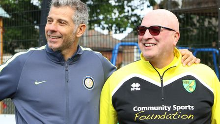 Francesco Toldo, left, and Bryan Gunn take a look at the Community Sports Foundation's facilities. P