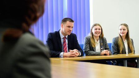Cromer Academy principal Dr Geoff Baker, pictured here with pupils, has been praised for his leaders