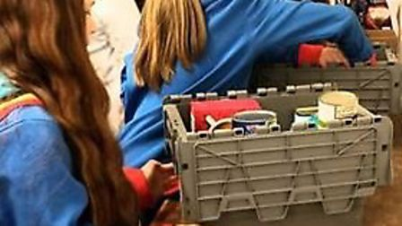 The girlguiding group heling to packfood parcels. Picture: Emily Pilsbury-Gaunt