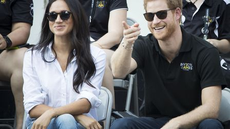 File photo dated of Prince Harry and Meghan Markle watching Wheelchair Tennis at the 2017 Invictus G