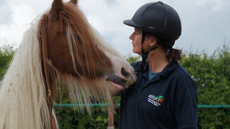 Julie Harding, here with Whitney, says 'Although I'm often involved in rescuing horses, a large part