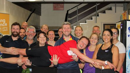 Ali Buck being held by those who took part in the spin-a-thon. Picture: South Norfolk Council