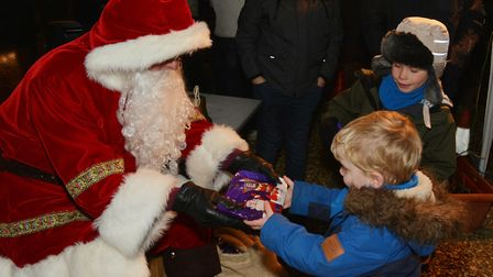Father Christmas hands out early Christmas presents. Picture: Peter Bird