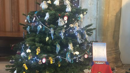 A tree decorated with mermaids and tinsel- complete with starfish topper. Picture: Eleanor Pringle