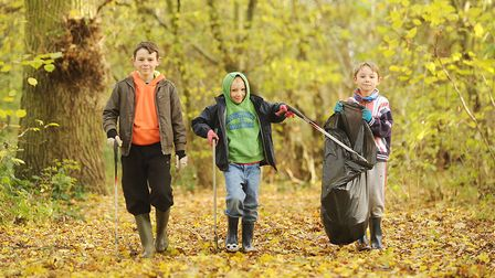 Young volunteers take partg in a previous clean-up. Picture: Ian Burt