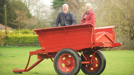 Peter Trent and Anne Prentis with the restored farm tumbril at Great Ryburgh. Picture: Ian Burt