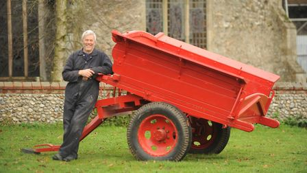 Peter Trent with the restored farm tumbril that is going up for auction to raise money for the St An