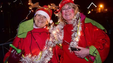 Wells Christmas Tide celebrations. Father Christmas helpers at the evening event. PHOTO: Nick But