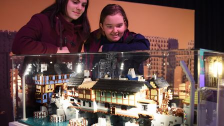 Ellie Jackman, and Holly Elson-Fisher, both 16, study the old London Bridge, at the Brick Wonders ex