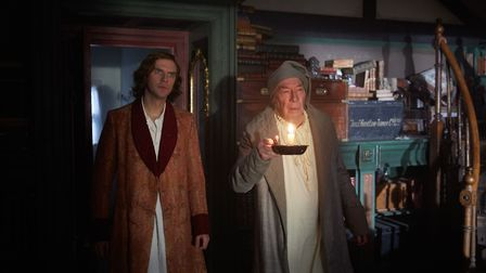 Dan Stevens as Charles Dickens and Christopher Plummer as Ebenezer Scrooge in The Man Who Invented C