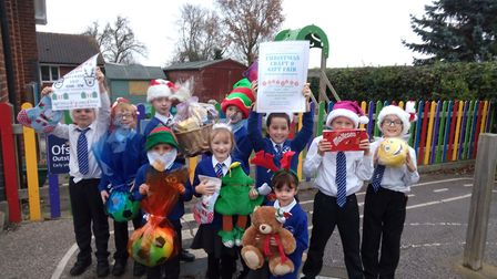 Children from Rollesby Primary School help to promote the school's Christmas Craft Fair. Picture: Em