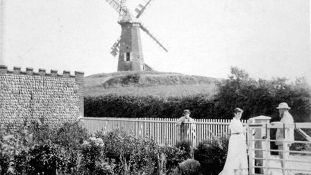 Echoes of History. Miller Jermy and daughter Louie in Mill House garden, with Sidestrand mill in the