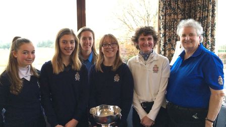 The successful Royal Norwich team line up with the club's ladies' vice-captain Jack Pett (right). Pi