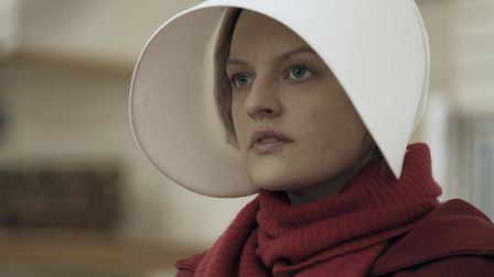 Offred (Elisabeth Moss) remembers the unconventional beginnings of her relationship with her husband